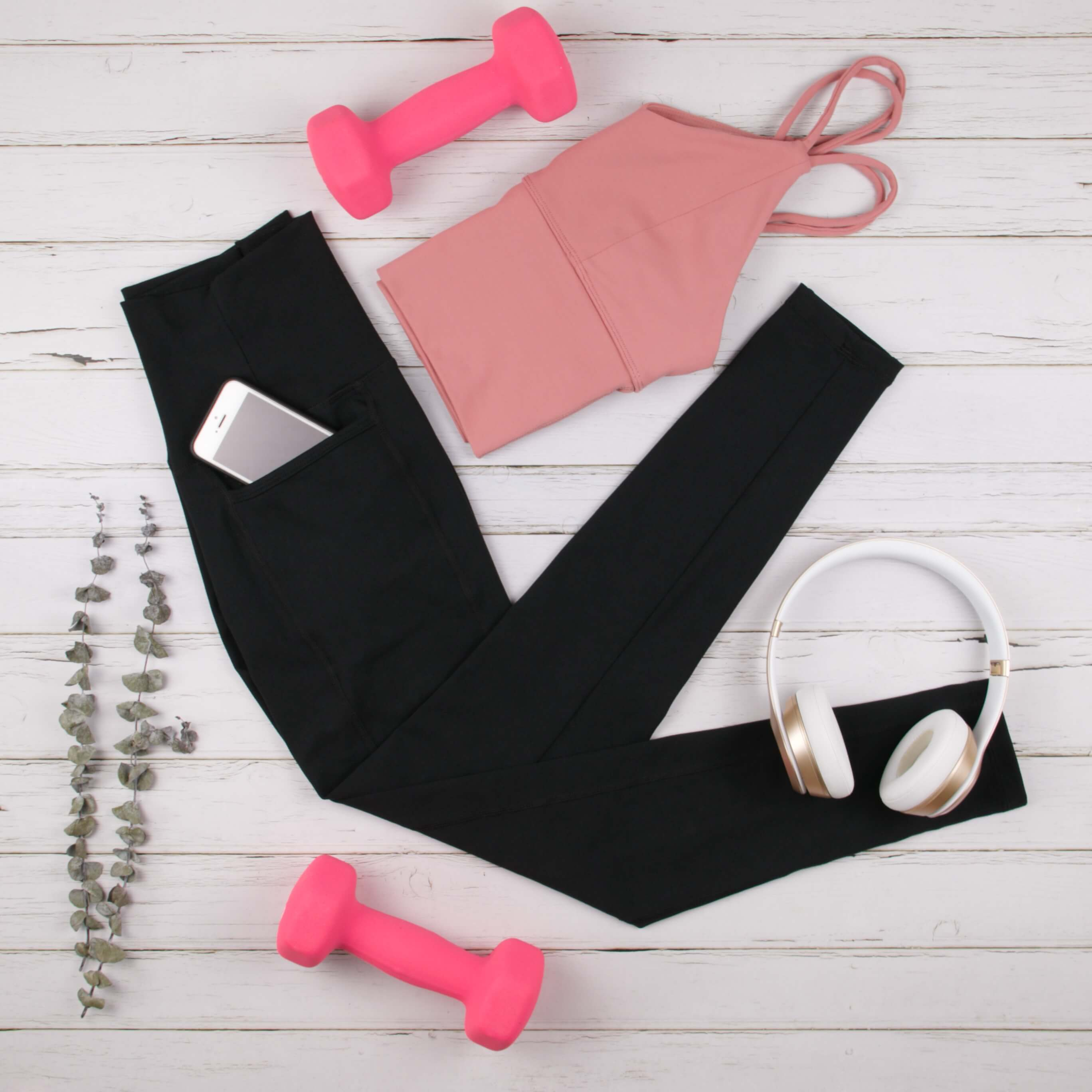 The Fitness Trends That You Don't Want to Miss in 2020 - Leggings with Pockets and Strappy Crop Tank Top Flat Lay - Utility and Comfort | Hummingbird