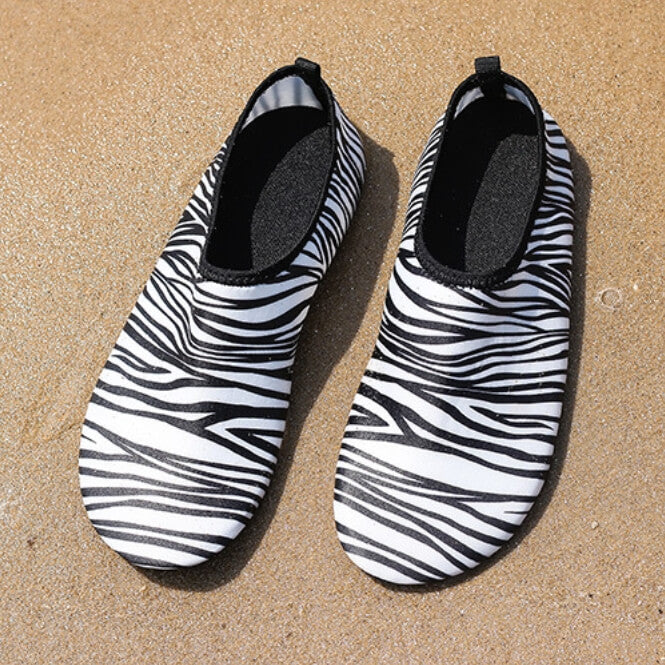 Zebra print minimalist water shoes on the beach - Staying in Shape on Beach Vacation with these Must-Have Minimalist Fitness Items | Hummingbird