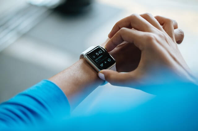 The Fitness Trends That You Don't Want to Miss in 2020 - Women in Blue Checking Out The Smart Watch She is Wearing - Wearable Devices | Hummingbird