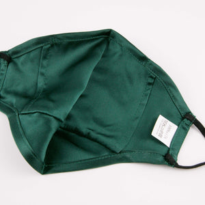 "Hummingbird Adjustable Vintage Mulberry Silk Face Mask - Green with a hidden pocket for removable filters. This 100% mulberry silk mask is skin friendly, breathable, smooth and soft. Unlike synthetic fabrics, natural silk does not cause allergies and discomfort to your skin. It helps retain moisture, maintains a healthy balance of skin water and oil, and prevents acne, or ""maskne"" breakouts. It's the most gentle mask for your delicate facial skin."