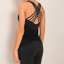 Load image into Gallery viewer, Demonstrate your back day effort with this 2 In 1 Crisscross Strappy Tank Top - Black. Featuring scoop neckline, crisscross spaghetti straps and oblique hems overlapping at center back, this cute tank is a must-have for your active life. Flattering detailing on the back not only highlights your hard back day effort, but also accentuates body curves. This buttery soft vest is perfect for low impact workouts like weight training, yoga, cycling, spinning, dancing and more.