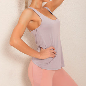 Demonstrate your back day effort with this 2 In 1 Crisscross Strappy Tank Top - Pastel Purple. Featuring scoop neckline, crisscross spaghetti straps and oblique hems overlapping at center back, this cute tank is a must-have for your active life. Flattering detailing on the back not only highlights your hard back day effort, but also accentuates body curves. This buttery soft vest is perfect for low impact workouts like weight training, yoga, cycling, spinning, dancing and more.