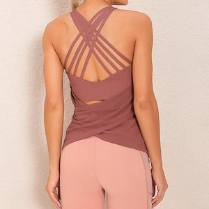 Demonstrate your back day effort with this 2 In 1 Crisscross Strappy Tank Top - Cinnamon. Featuring scoop neckline, crisscross spaghetti straps and oblique hems overlapping at center back, this cute tank is a must-have for your active life. Flattering detailing on the back not only highlights your hard back day effort, but also accentuates body curves. This buttery soft vest is perfect for low impact workouts like weight training, yoga, cycling, spinning, dancing and more.