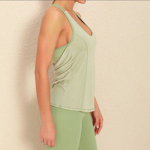 Demonstrate your back day effort with this 2 In 1 Halter Strappy Tank Top - Lime. This soft vest contains a formfitting sports bra and a breathable loose-fitting outer layer to facilitate your workouts. Featuring scoop neckline, spaghetti straps, center back cutout and scoop back hem, this flattering tank is a must-have for your active life. Delicate details on the back not only highlights your hard back day effort, but also accentuates body curves. Perfect for low impact exercise.