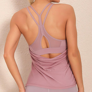Demonstrate your back day effort with this 2 In 1 Halter Strappy Tank Top - Wine. This soft vest contains a formfitting sports bra and a breathable loose-fitting outer layer to facilitate your workouts. Featuring scoop neckline, spaghetti straps, center back cutout and scoop back hem, this flattering tank is a must-have for your active life. Delicate details on the back not only highlights your hard back day effort, but also accentuates body curves. Perfect for low impact exercise.