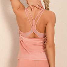 Load image into Gallery viewer, Demonstrate your back day effort with this 2 In 1 Halter Strappy Tank Top - Peach. This soft vest contains a formfitting sports bra and a breathable loose-fitting outer layer to facilitate your workouts. Featuring scoop neckline, spaghetti straps, center back cutout and scoop back hem, this flattering tank is a must-have for your active life. Delicate details on the back not only highlights your hard back day effort, but also accentuates body curves. Perfect for low impact exercise.
