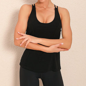 Demonstrate your back day effort with this 2 In 1 Halter Strappy Tank Top - Black. This soft vest contains a formfitting sports bra and a breathable loose-fitting outer layer to facilitate your workouts. Featuring scoop neckline, spaghetti straps, center back cutout and scoop back hem, this flattering tank is a must-have for your active life. Delicate details on the back not only highlights your hard back day effort, but also accentuates body curves. Perfect for low impact exercise.