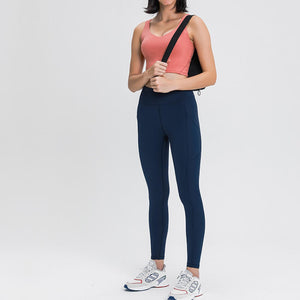 Carry your essentials with ease while you exercise in these Solid 7/8 Leggings with Pockets-Midnight Blue. Featuring mid rise waistband and deep side pockets, these fitted workout leggings are perfect for jogging, yoga, weight training, and running errands. Side pockets can store essentials like a phone, keys, cards. Hidden waistband pocket in center back is another site for IDs or keys. Aesthetic seams accentuate body curves. Buttery soft fabric with a brushed feel enables performance even when it's cold.