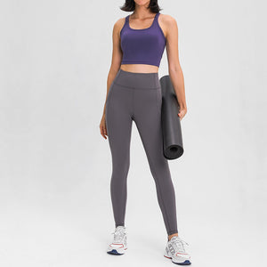 Carry your essentials with ease while you exercise in these Solid 7/8 Leggings with Pockets - Grey. Featuring mid rise waistband and deep side pockets, these fitted workout leggings are perfect for jogging, yoga, weight training, and running errands. Side pockets can store essentials like a phone, keys, cards. Hidden waistband pocket in center back is another site for IDs or keys. Aesthetic seams accentuate body curves. Buttery soft fabric with a brushed feel enables performance even when it's cold.