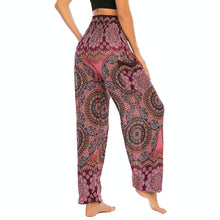 Load image into Gallery viewer, Empower your energy flow and blood circulation during yoga practice with these Bohemian Geometric Circle Mandala Yoga Harem Pants - Burgundy. Featuring circle and geometric mandalas, these loose fitting yoga pants are the must-have companion for your yoga journey, be it for asanas, pranayama, or meditation. With high rise smocked waist and elastic ankles, these loose yoga pants can be adjusted to different styles. Handmade by Thai people with natural plant dye techniques. Also perfect for holiday travel.