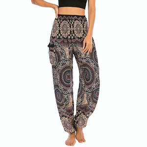 Empower your energy flow and blood circulation during yoga practice with these Bohemian Geometric Circle Mandala Yoga Harem Pants - Black. Featuring circle and geometric mandalas, these loose fitting yoga pants are the must-have companion for your yoga journey, be it for asanas, pranayama, or meditation. With high rise smocked waist and elastic ankles, these loose yoga pants can be adjusted to different styles. Handmade by Thai people with natural plant dye techniques. Also perfect for holiday travel.