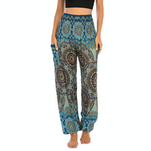 Load image into Gallery viewer, Empower your energy flow and blood circulation during yoga practice with these Bohemian Geometric Circle Mandala Yoga Harem Pants - Maya Blue. Featuring circle and geometric mandalas, these loose fitting yoga pants are the must-have companion for your yoga journey, be it for asanas, pranayama, or meditation. With high rise smocked waist and elastic ankles, these loose yoga pants can be adjusted to different styles. Handmade by Thai people with natural plant dye techniques. Also perfect for holiday travel.