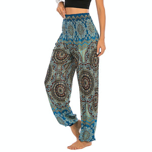 Empower your energy flow and blood circulation during yoga practice with these Bohemian Geometric Circle Mandala Yoga Harem Pants - Maya Blue. Featuring circle and geometric mandalas, these loose fitting yoga pants are the must-have companion for your yoga journey, be it for asanas, pranayama, or meditation. With high rise smocked waist and elastic ankles, these loose yoga pants can be adjusted to different styles. Handmade by Thai people with natural plant dye techniques. Also perfect for holiday travel.