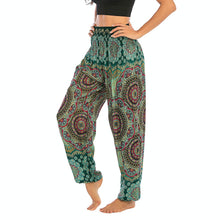 Load image into Gallery viewer, Empower your energy flow and blood circulation during yoga practice with these Bohemian Geometric Circle Mandala Yoga Harem Pants - Teal. Featuring circle and geometric mandalas, these loose fitting yoga pants are the must-have companion for your yoga journey, be it for asanas, pranayama, or meditation. With high rise smocked waist and elastic ankles, these loose yoga pants can be adjusted to different styles. Handmade by Thai people with natural plant dye techniques. Also perfect for holiday travel.