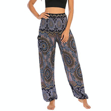 Load image into Gallery viewer, Empower your energy flow and blood circulation during yoga practice with these Bohemian Geometric Circle Mandala Yoga Harem Pants - Cornflower. Featuring circle and geometric mandalas, these loose fitting yoga pants are the must-have companion for your yoga journey, be it for asanas, pranayama, or meditation. With high rise smocked waist and elastic ankles, these loose yoga pants can be adjusted to different styles. Handmade by Thai people with natural plant dye techniques. Also perfect for holiday travel.