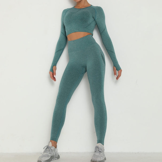 Make the most of leg day in this Booty Scrunch Leggings & Crop Top Set - Smoked Turquoise. This matching workout set comes with a long sleeve crop top and a pair of booty scrunch leggings. Crop top features raglan sleeves with thumbholes and a ruched detail on center chest. Leggings are high-waist fitted with booty scrunch, underbutt mesh panels and ribbed sides. This cute 2 piece workout set is perfect for all sorts of indoor and outdoor activities such as weight training, jogging, bar and more.