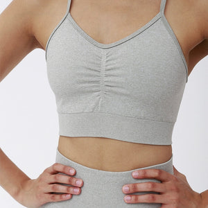 This Candy Scrunch Seamless Sports Set - Silver comes with a low impact adjustable spaghetti strap sports bra. Racer back offers additional support for the upper body. Ruched detail on center chest echoes booty scrunch. Widened waistband lies flat against your skin and won't dig in. Seamless fabrication reduces chafing and four-way stretch material is moisture-wicking. Perfect for all sorts of workout activities.