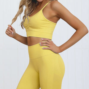 This Candy Scrunch Seamless Sports Set - Mango comes with a low impact adjustable spaghetti strap sports bra and a pair of high waisted booty scrunch leggings. Individual items with extra colors are available. Ruched detail on center chest echoes booty scrunch. Widened waistband lies flat against your skin and won't dig in, along with reinforcing underbutt panels and booty scrunch design, these leggings accentuate mid to lower body curves. Perfect for low impact activities.