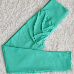 This Candy Scrunch Seamless Sports Set - Aqua comes with a low impact adjustable spaghetti strap sports bra and a pair of high waisted booty scrunch leggings. Individual items with extra colors are available. Ruched detail on center chest echoes booty scrunch. Widened waistband lies flat against your skin and won't dig in, along with reinforcing underbutt panels and booty scrunch design, these leggings accentuate mid to lower body curves.
