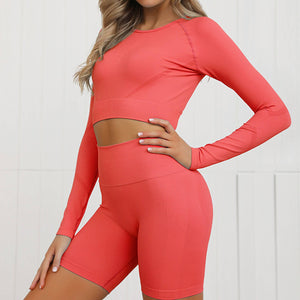 Complete the candy scrunch collection with this Candy Scrunch Seamless Biker Shorts Set A - Cherry, which comes with a raglan long sleeve crop top and a pair of high waisted booty scrunch biker shorts. Ruched detail on center chest echoes booty scrunch. Widened waistband lies flat against your skin and won't dig in, along with reinforcing underbutt panels and booty scrunch design, these biker shorts accentuate mid to lower body curves.