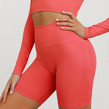 Load image into Gallery viewer, This Candy Scrunch Seamless Biker Shorts Set - Cherry comes with a pair of high waisted booty scrunch biker shorts. Ruched detail on center chest echoes booty scrunch. Widened waistband lies flat against your skin and won't dig in, along with reinforcing underbutt panels and booty scrunch design, these biker shorts accentuate mid to lower body curves. Seamless fabrication reduces chafing and four-way stretch material is moisture-wicking. Perfect for all sorts of workout activities.