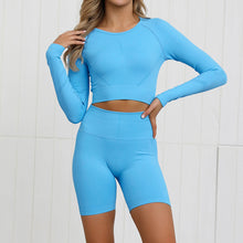 Load image into Gallery viewer, Complete the candy scrunch collection with this Candy Scrunch Seamless Biker Shorts Set A - Blue Raspberry, which comes with a raglan long sleeve crop top and a pair of high waisted booty scrunch biker shorts. Ruched detail on center chest echoes booty scrunch. Widened waistband lies flat against your skin and won't dig in, along with reinforcing underbutt panels and booty scrunch design, these biker shorts accentuate mid to lower body curves.