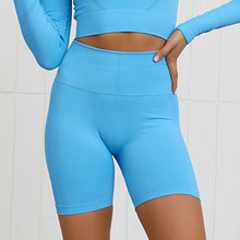Load image into Gallery viewer, This Candy Scrunch Seamless Biker Shorts Set - Blue Raspberry comes with a pair of high waisted booty scrunch biker shorts. Ruched detail on center chest echoes booty scrunch. Widened waistband lies flat against your skin and won't dig in, along with reinforcing underbutt panels and booty scrunch design, these biker shorts accentuate mid to lower body curves. Seamless fabrication reduces chafing and four-way stretch material is moisture-wicking. Perfect for all sorts of workout activities.
