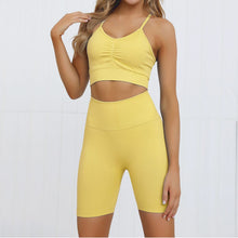 Load image into Gallery viewer, This Candy Scrunch Seamless Biker Shorts Set B - Mango comes with a low impact adjustable spaghetti strap sports bra and a pair of high waisted booty scrunch biker shorts. Racer back of the sports bra offers additional support for the upper body. Ruched detail on center chest echoes booty scrunch. Widened waistband lies flat against your skin and won't dig in, along with reinforcing underbutt panels and booty scrunch design, these biker shorts accentuate mid to lower body curves.