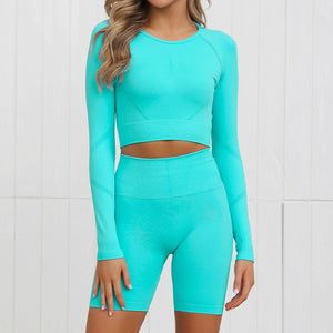 Complete the candy scrunch collection with this Candy Scrunch Seamless Biker Shorts Set A - Aqua, which comes with a raglan long sleeve crop top and a pair of high waisted booty scrunch biker shorts. Ruched detail on center chest echoes booty scrunch. Widened waistband lies flat against your skin and won't dig in, along with reinforcing underbutt panels and booty scrunch design, these biker shorts accentuate mid to lower body curves.
