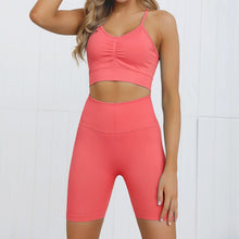 Load image into Gallery viewer, This Candy Scrunch Seamless Biker Shorts Set B - Cherry comes with a low impact adjustable spaghetti strap sports bra and a pair of high waisted booty scrunch biker shorts. Racer back of the sports bra offers additional support for the upper body. Ruched detail on center chest echoes booty scrunch. Widened waistband lies flat against your skin and won't dig in, along with reinforcing underbutt panels and booty scrunch design, these biker shorts accentuate mid to lower body curves.