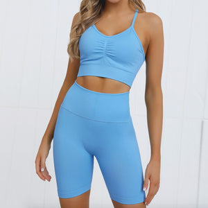 This Candy Scrunch Seamless Biker Shorts Set B - Blue Raspberry comes with a low impact adjustable spaghetti strap sports bra and a pair of high waisted booty scrunch biker shorts. Racer back of the sports bra offers additional support for the upper body. Ruched detail on center chest echoes booty scrunch. Widened waistband lies flat against your skin and won't dig in, along with reinforcing underbutt panels and booty scrunch design, these biker shorts accentuate mid to lower body curves.