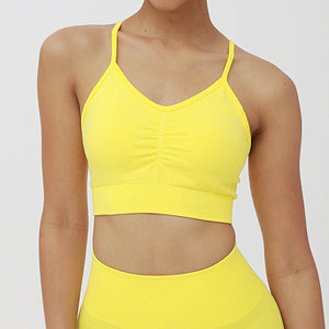 Individual Candy Scrunch Sports Bra - Lemon with low impact adjustable spaghetti strap is available for this Candy Scrunch Seamless Biker Shorts Set. Racer back offers additional support for the upper body. Ruched detail on center chest echoes booty scrunch. Widened waistband lies flat against your skin and won't dig in. Seamless fabrication reduces chafing and four-way stretch material is moisture-wicking. Perfect for all sorts of workout activities.