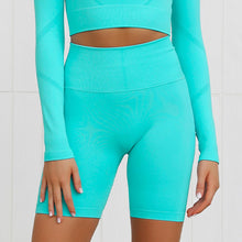 Load image into Gallery viewer, This Candy Scrunch Seamless Biker Shorts Set - Aqua comes with a pair of high waisted booty scrunch biker shorts. Ruched detail on center chest echoes booty scrunch. Widened waistband lies flat against your skin and won't dig in, along with reinforcing underbutt panels and booty scrunch design, these biker shorts accentuate mid to lower body curves. Seamless fabrication reduces chafing and four-way stretch material is moisture-wicking. Perfect for all sorts of workout activities.