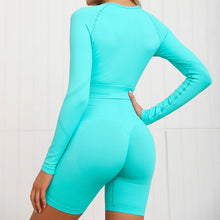 Load image into Gallery viewer, Complete the candy scrunch collection with this Candy Scrunch Seamless Biker Shorts Set A - Aqua, which comes with a raglan long sleeve crop top and a pair of high waisted booty scrunch biker shorts. Ruched detail on center chest echoes booty scrunch. Widened waistband lies flat against your skin and won't dig in, along with reinforcing underbutt panels and booty scrunch design, these biker shorts accentuate mid to lower body curves.