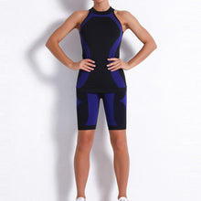 Load image into Gallery viewer, Necessitate self-discipline with this Contrast Seamless Cosmo Tank & Biker Shorts Set - Navy. This matching workout set includes a tank top and a pair of biker shorts.Tank top has a high neck and is snugly fitted, supporting your movement as the final layer no matter what exercise you are engaging in. Biker shorts are high-waist fitted with above the knee length. Extensive and aesthetic ribbed panels accentuate your hard effort through self-discipline.