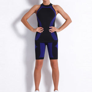Necessitate self-discipline with this Contrast Seamless Cosmo Tank & Biker Shorts Set - Navy. This matching workout set includes a tank top and a pair of biker shorts.Tank top has a high neck and is snugly fitted, supporting your movement as the final layer no matter what exercise you are engaging in. Biker shorts are high-waist fitted with above the knee length. Extensive and aesthetic ribbed panels accentuate your hard effort through self-discipline.