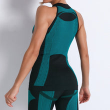 Load image into Gallery viewer, Necessitate self-discipline with this Contrast Seamless Cosmo Tank & Biker Shorts Set - Teal. This matching workout set includes a tank top and a pair of biker shorts.Tank top has a high neck and is snugly fitted, supporting your movement as the final layer no matter what exercise you are engaging in. Biker shorts are high-waist fitted with above the knee length. Extensive and aesthetic ribbed panels accentuate your hard effort through self-discipline.