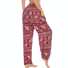 Load image into Gallery viewer, Featuring white elephants, geometric and floral elements, these Drawstring Elephant Diamond Loose Yoga Pants - Burgundy are the must-have companion for your yoga journey, be it for asanas, pranayama, or meditation. With high rise smocked waist, elastic ankles and an adjustable drawstring, these loose yoga pants can be adjusted to fit most body types. Handmade with breathable, soft, lightweight and quick dry fabric and natural dyeing techniques. Perfect for yoga, meditation, dancing or vacations.
