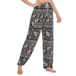 Featuring white elephants, geometric and floral elements, these Drawstring Elephant Diamond Loose Yoga Pants - Black are the must-have companion for your yoga journey, be it for asanas, pranayama, or meditation. With high rise smocked waist, elastic ankles and an adjustable drawstring, these loose yoga pants can be adjusted to fit most body types. Handmade with breathable, soft, lightweight and quick dry fabric and natural dyeing techniques. Perfect for yoga, meditation, dancing or vacations.