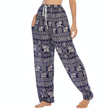 Load image into Gallery viewer, Featuring white elephants, geometric and floral elements, these Drawstring Elephant Diamond Loose Yoga Pants - Navy are the must-have companion for your yoga journey, be it for asanas, pranayama, or meditation. With high rise smocked waist, elastic ankles and an adjustable drawstring, these loose yoga pants can be adjusted to fit most body types. Handmade with breathable, soft, lightweight and quick dry fabric and natural dyeing techniques. Perfect for yoga, meditation, dancing or vacations.