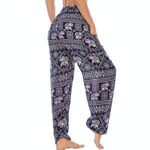 Featuring white elephants, geometric and floral elements, these Drawstring Elephant Diamond Loose Yoga Pants - Navy are the must-have companion for your yoga journey, be it for asanas, pranayama, or meditation. With high rise smocked waist, elastic ankles and an adjustable drawstring, these loose yoga pants can be adjusted to fit most body types. Handmade with breathable, soft, lightweight and quick dry fabric and natural dyeing techniques. Perfect for yoga, meditation, dancing or vacations.