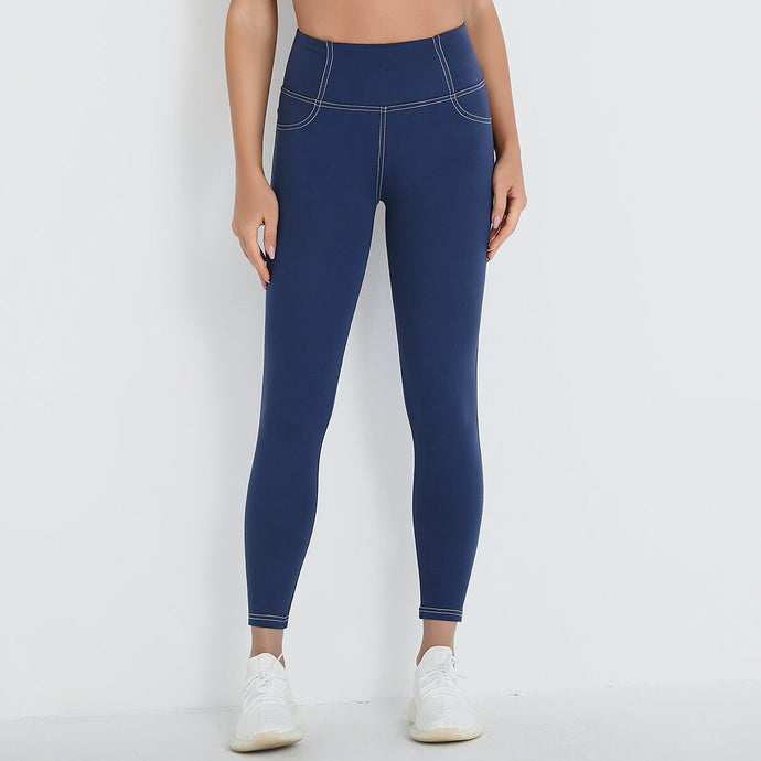 Bring your athleisure look to the next level with these Faux Denim Pocket Ankle Leggings - Indigo. Look like skinny jeans but feel like leggings, these ankle gym leggings can accompany you from gym to street, from work from home to workout at home. Leggings feature jean-like seams, faux front pockets and functional back pockets. Stretchy nylon and spandex blend fabric and widened ribbed waistband sculpt and lift your lower body.