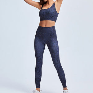 Make a purr-fect statement in this Feline Asymmetrical Sports Bra & Leggings Set - Lunar Blue. This matching workout set comes with a padded sports bra and a pair of leggings. Padded sports bra features asymmetrical shoulder straps. Leggings are mid-rise fitted. Stylish cheetah print shows your wild side in action. This 2 piece workout set is ideal for all sorts of activities from yoga to gym to street.