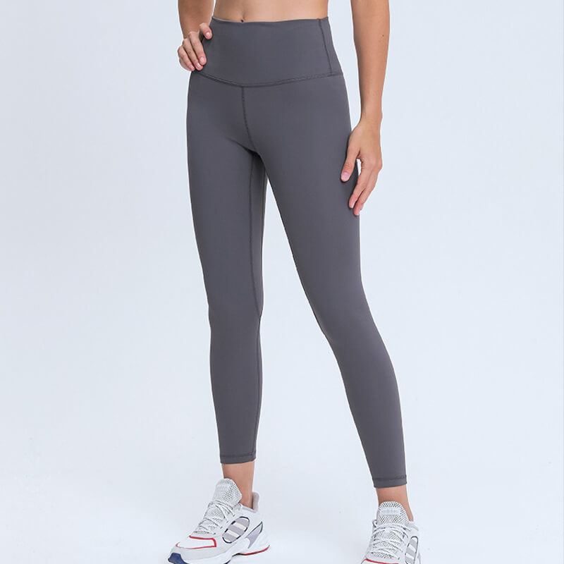 With these Fleece Lined Hidden Pocket 7/8 Leggings - Grey, even cold and blustery winter can't dominate your workout. These thermal leggings feature a waistband pocket designed for small essentials such as a key or ID. A brushed fleece interior made of a polyester and spandex blend not only keeps in warmth, but also wicks moisture. These ultra-soft, stretchy and breathable fleece lined 7/8 leggings are perfect for exercise, errand running, lounging as well as working from home.