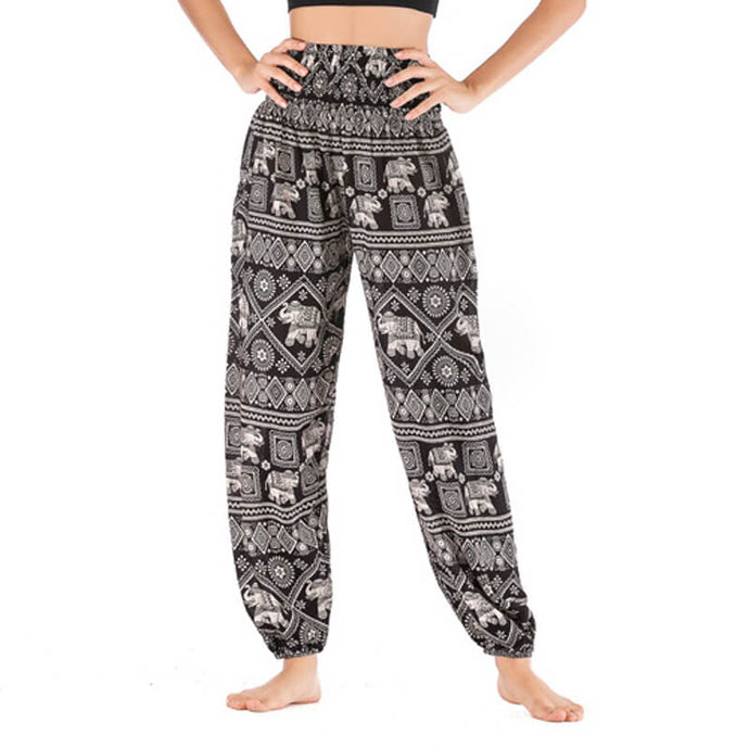 Featuring white elephants, geometric and floral elements, these Handmade Smocked Waist Elephant Diamond Loose Yoga Pants - Black are the must-have companion for your yoga journey, be it for asanas, pranayama, or meditation. With high rise smocked waist, elastic ankles and an adjustable drawstring, these loose yoga pants can be adjusted to fit most body types. Handmade with breathable, soft, lightweight and quick dry fabric and natural dyeing techniques. Perfect for yoga, meditation, dancing or vacations.