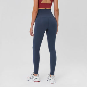 Complete the studio to street look with these Solid High Waist Hidden Pocket Leggings - Midnight Blue. Featuring high rise waistband with a hidden key pocket, these fitted workout leggings are perfect for yoga, weightlifting, jogging and more, as well as running errands. Buttery soft material with a brushed feel is breathable and moisture-wicking. Ultra high waist is a perfect match with longline crop tops like our V Neck Crop Tank Longline Sports Bra.