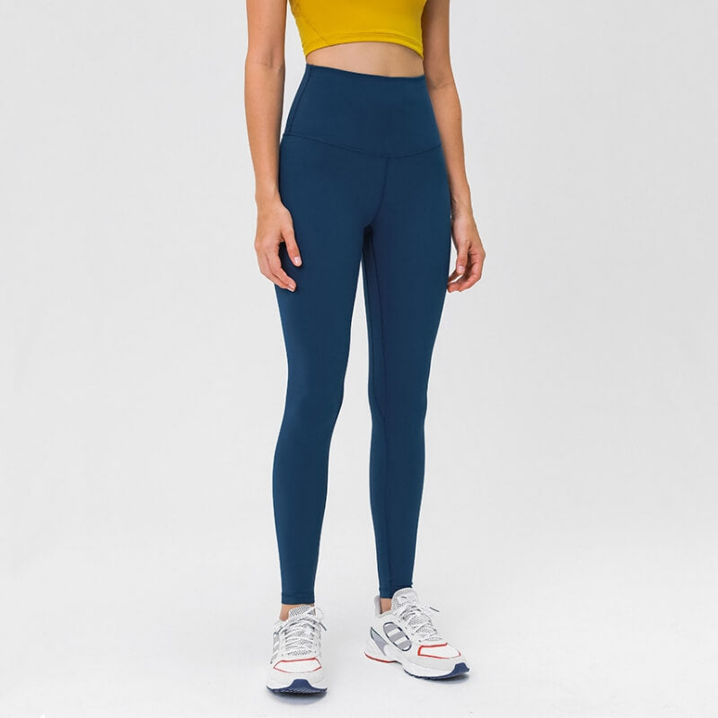 Complete the studio to street look with these Solid High Waist Hidden Pocket Leggings - Sapphire Blue. Featuring high rise waistband with a hidden key pocket, these fitted workout leggings are perfect for yoga, weightlifting, jogging and more, as well as running errands. Buttery soft material with a brushed feel is breathable and moisture-wicking. Ultra high waist is a perfect match with longline crop tops like our V Neck Crop Tank Longline Sports Bra.