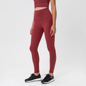Complete the studio to street look with these Solid High Waist Hidden Pocket Leggings - Burgundy. Featuring high rise waistband with a hidden key pocket, these fitted workout leggings are perfect for yoga, weightlifting, jogging and more, as well as running errands. Buttery soft material with a brushed feel is breathable and moisture-wicking. Ultra high waist is a perfect match with longline crop tops like our V Neck Crop Tank Longline Sports Bra.