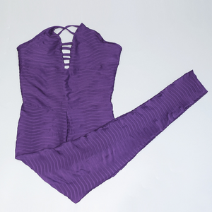 Hummingbird Hollowed Back Ribbed Jumpsuit with breathable and wicking fabric, as well as fashionable design.