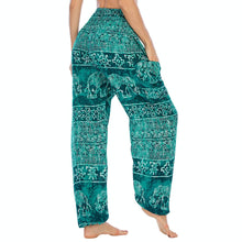Load image into Gallery viewer, Empower your energy flow during yoga practice with these Hummingbird Ink Washed Elephant Tribal Loose Yoga Pants - Turquoise. Elephants, a symbol of strength, durability and longevity, have important significance in Asian cultures. Featuring ink washed elephants and tribal elements, these loose harem pants are the must-have companion for your yoga journey, be it for asanas, pranayama, or meditation. Handmade with natural dyeing techniques. Perfect for yoga, meditation, dancing or daily wear.
